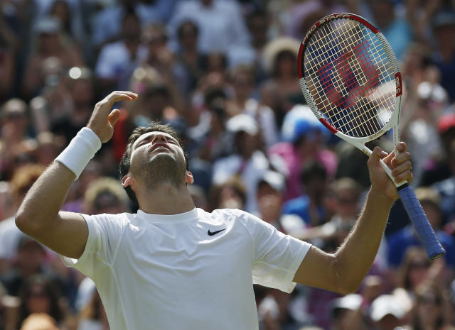 Grigor Dimitrov of Bulgaria celebrates after defeating defending champion Andy Murray of Britain in their men's singles quarterfinal match at the All England Lawn Tennis Championships in Wimbledon, London, Wednesday July 2, 2014. (AP Photo/Pavel Golovkin)
