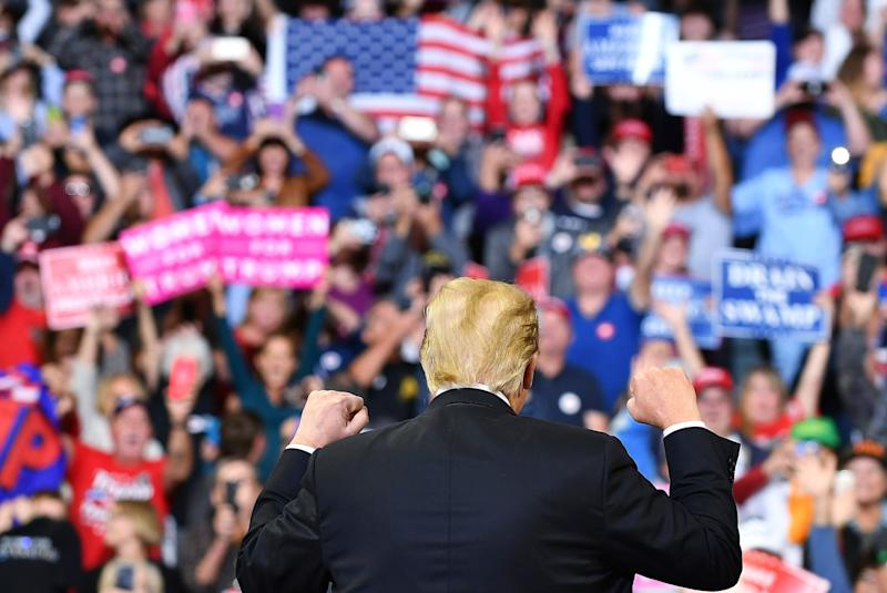 The crowd jeered at Sen. Dianne Feinstein (D-Calif.) as Trump accused her of leaking Christine Blasey Ford's letter accusing Brett Kavanaugh of sexual assault. Trump didn't provide any evidence for his claim. (MANDEL NGAN via Getty Images)