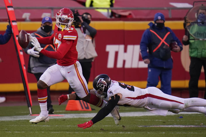 Atlanta Falcons Luke Stocker dives to tackle Kansas City Chiefs linebacker Darius Harris (47) after he recovered a fumble by Falcons Brandon Powell during the second half of an NFL football game, Sunday, Dec. 27, 2020, in Kansas City. (AP Photo/Jeff Roberson)
