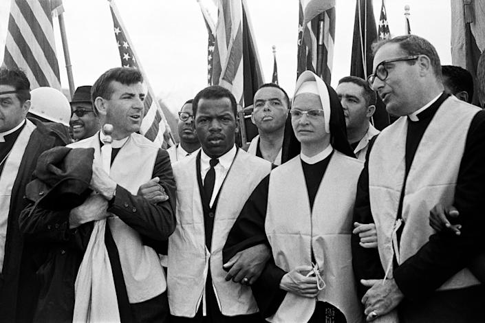 At the head of the march from Selma to Montgomery on March 25, 1965, nuns, priests and civil rights leaders: The Rev. Arthur Matott (from left), John Lewis (head of the Student Nonviolent Coordinating Committee), Andrew Young, Sister Mary Leoline and Theodore Gill. (Photo: Stephen F. Somerstein via Getty Images)