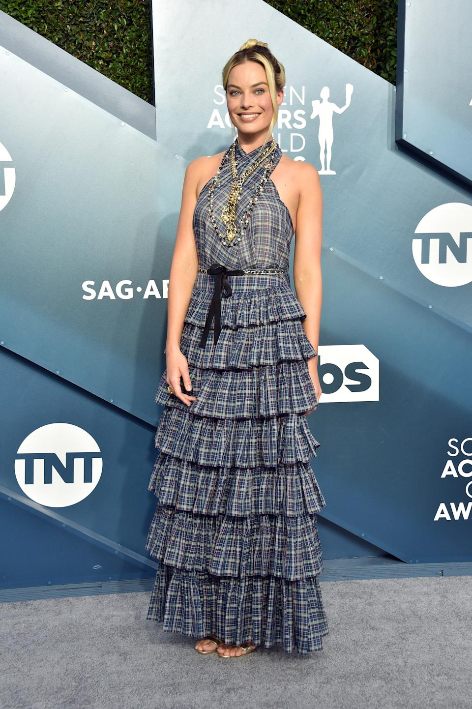 """Robbie chose a ruffled, tartan Chanel to celebrate a combined eight nominations for her films """"Bombshell"""" and """"Once Upon a Time...In Hollywood."""""""