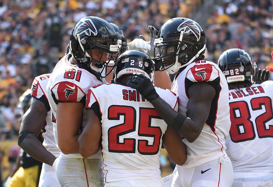 Oct 7, 2018; Pittsburgh, PA, USA;  Atlanta Falcons running back Ito Smith (25) is greeted by his teammates after scoring a fourth quarter touchdown against the Pittsburgh Steelers at Heinz Field. The Steelers won 41-17.  Mandatory Credit: Philip G. Pavely-USA TODAY Sports