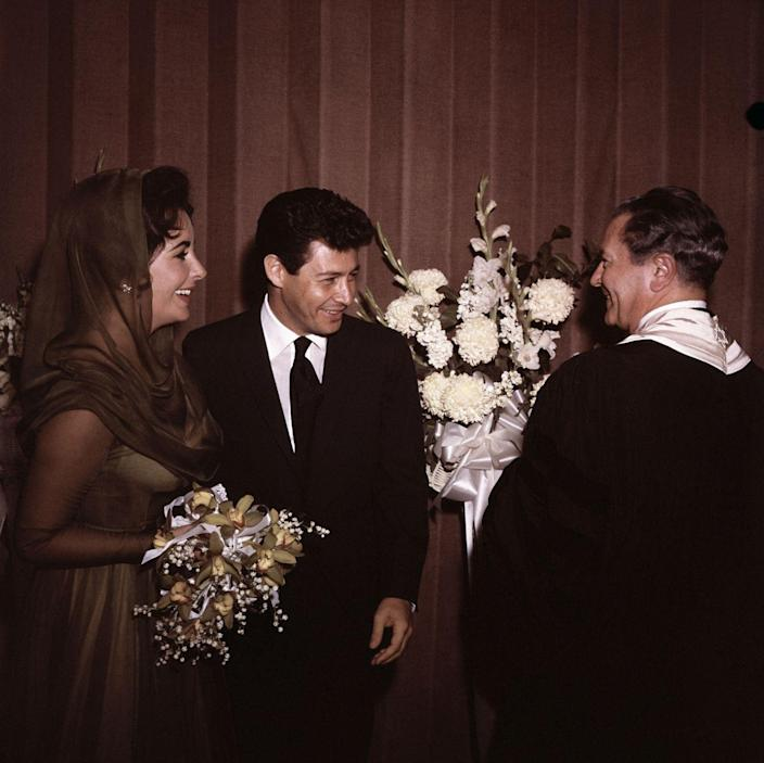 """<p>Elizabeth Taylor said """"I do"""" three times in the '50s, but her wedding to Eddie Fisher was the most scandalous, as he was married to her best friend, Debbie Reynolds, at the start of their relationship. The couple got married in Las Vegas at the Temple Beth Shalom. </p>"""
