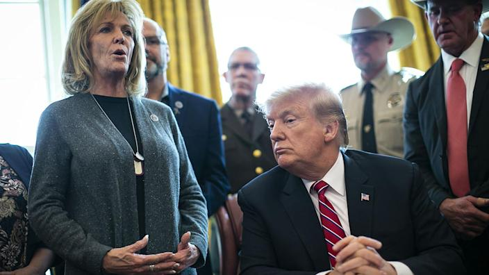 Mary Ann Mendoza, an advocate for harsher immigration enforcement, speaks alongside President Trump in the White House on March 15, 2019, when Trump vetoed Congress's effort to cancel his declaration of a national emergency to pay for a wall on the U.S.-Mexico border. (Al Drago/Bloomberg via Getty Images)
