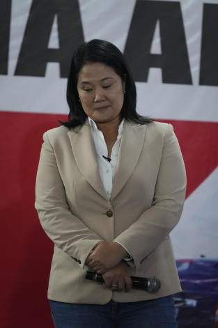 Presidential candidate Keiko Fujimori holds a press conference in Lima, Peru, Thursday, June 10, 2021. As one claims victory and the other electoral fraud, tensions continue to grow around Peru's presidential election run-off vote count with just decimals of percentage points separating left leaning Pedro Castillo from rightwing populist rival Keiko Fujimori. (AP Photo/Martin Mejia)