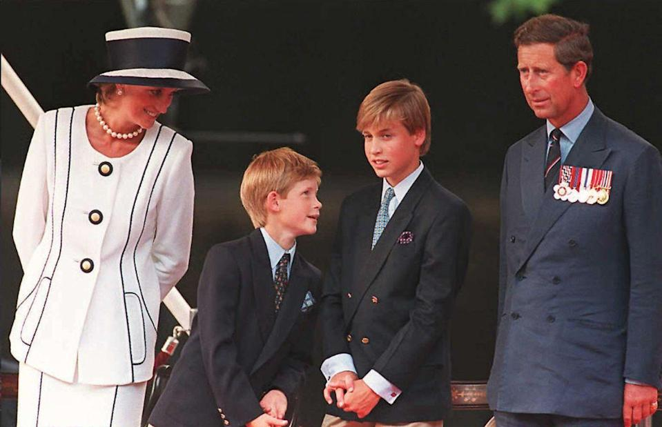 <p>Princess Di and her two growing boys happily watch the VJ Day parade together outside Buckingham Palace in 1995. </p>
