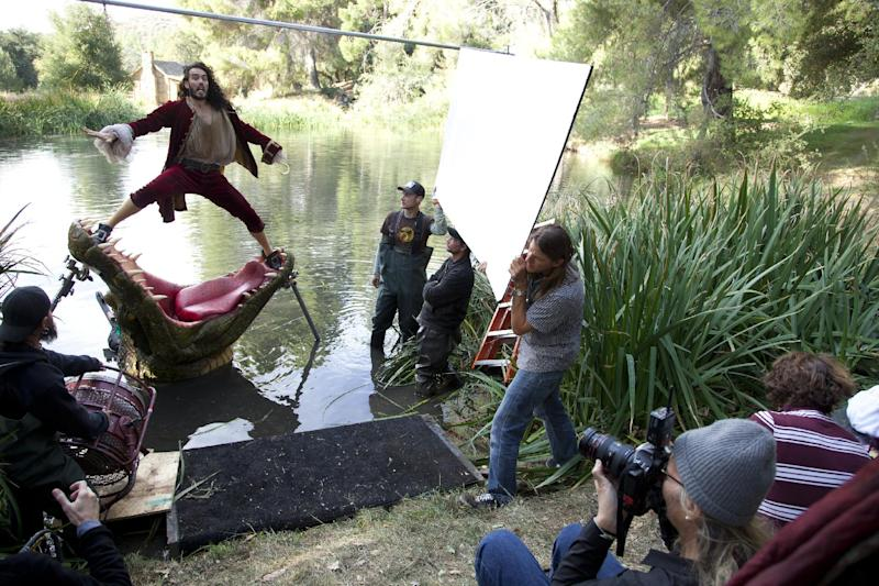 "This Nov. 3, 2011 photo released by Disney on Aug. 1, 2012 shows British actor Russell Brand dressed as Captain Hook from ""Peter Pan"" during a photo shoot with photographer Annie Leibovitz, right, for the Disney Dream Portrait series near Newhall, Calif. The portrait series features celebrities set in Disney fantasy settings. The images by Leibovitz will be used as a special insert in fall issues of ""GQ,"" ""O – The Oprah Magazine,"" ""People,"" ""People En Español,"" ""Vanity Fair,"" ""Real Simple,"" ""Essence,"" and ""InStyle,"" to promote Disney theme parks. (AP Photo/Disney Parks.com, Scott Brinegar)"