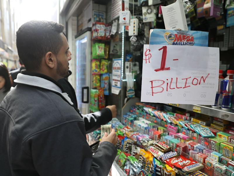 Customers line up to buy Mega Millions tickets at a newsstand in midtown Manhattan, New York: Mike Sugar/Reuters