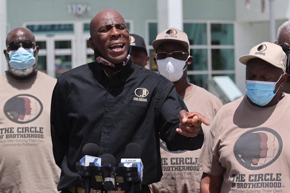 The executive director of the Circle of Brotherhood, Lyle Muhammad, holds a press conference outside of Miami Beach Police Department Headquarters prior to meeting with Miami Beach's police chief on Wednesday, Aug. 4, 2021.