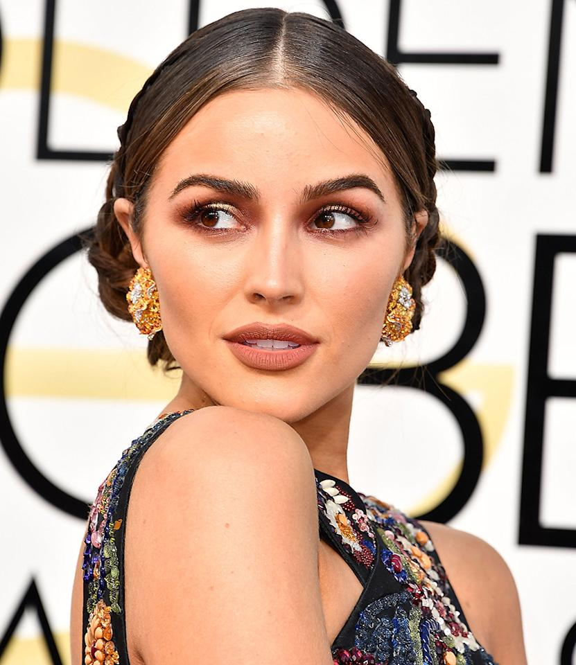 <p>Copy Olivia Culpo's bronze smoky eyeshadow and braided updo to turn heads as you toast your high school years. (Photo: WireImage) </p>