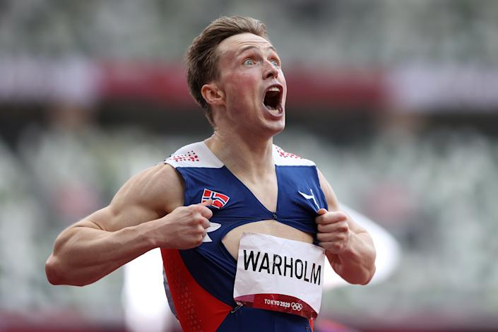 <p>Karsten Warholm of Team Norway reacts after winning the gold medal in the Men's 400m Hurdles Final on day eleven of the Tokyo 2020 Olympic Games at Olympic Stadium on August 03, 2021 in Tokyo, Japan. (Photo by Michael Steele/Getty Images)</p>