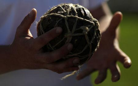 Sergei Glukhov holds a traditional Mordovian soccer ball (lapotball) at a Mordovian culture exhibition at a square in downtown of Saransk, Russia June 17, 2018. Picture taken June 17, 2018. REUTERS/Ricardo Moraes