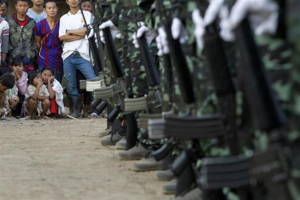 Soldiers stand side-by-side during the 63rd anniversary of Karen Revolution Day at Oo Kray Kee Township in the Karen State, along the Thai-Myanmar border, January 31, 2012.
