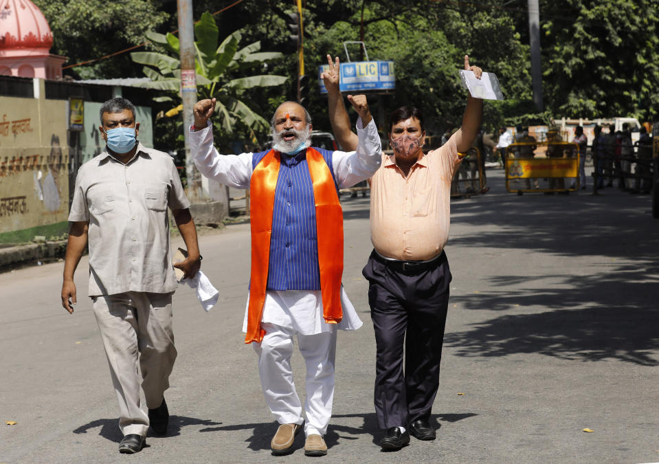 Jai Bhagwan Goyal, center, a leader of India's ruling Bharatiya Janata Party and an accused in the 1992 attack and demolition of a 16th century mosque, celebrates outside a court in Lucknow, India, Wednesday, Sept. 30, 2020. An Indian court on Wednesday acquitted all 32 accused, including senior leaders of the ruling Hindu nationalist Bharatiya Janata Party, in the case. The demolition sparked Hindu-Muslim violence that left some 2,000 people dead. (AP Photo/Rajesh Kumar Singh)