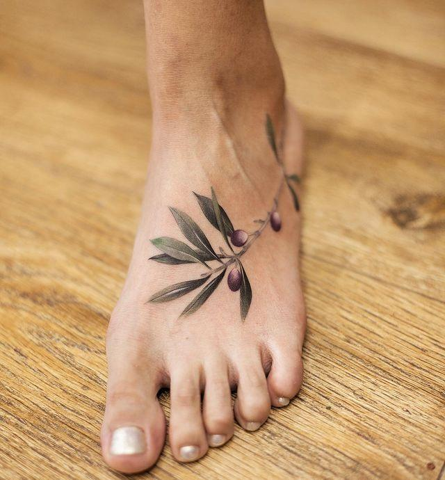 "<p>This olive-leaf tattoo will look so freakin' pretty with a <a href=""https://www.cosmopolitan.com/style-beauty/beauty/g9262018/nude-nail-polish-colors/"" rel=""nofollow noopener"" target=""_blank"" data-ylk=""slk:neutral nail polish"" class=""link rapid-noclick-resp"">neutral nail polish</a> (may I suggest <a href=""https://www.amazon.com/ZOYA-Nail-Polish-Brigitte/dp/B01M6A3MAB/?th=1&tag=syn-yahoo-20&ascsubtag=%5Bartid%7C10063.g.35213232%5Bsrc%7Cyahoo-us"" rel=""nofollow noopener"" target=""_blank"" data-ylk=""slk:Zoya's Brigitte"" class=""link rapid-noclick-resp"">Zoya's Brigitte</a>?).</p><p><a href=""https://www.instagram.com/p/Bx4bIl1AzSJ/"" rel=""nofollow noopener"" target=""_blank"" data-ylk=""slk:See the original post on Instagram"" class=""link rapid-noclick-resp"">See the original post on Instagram</a></p>"