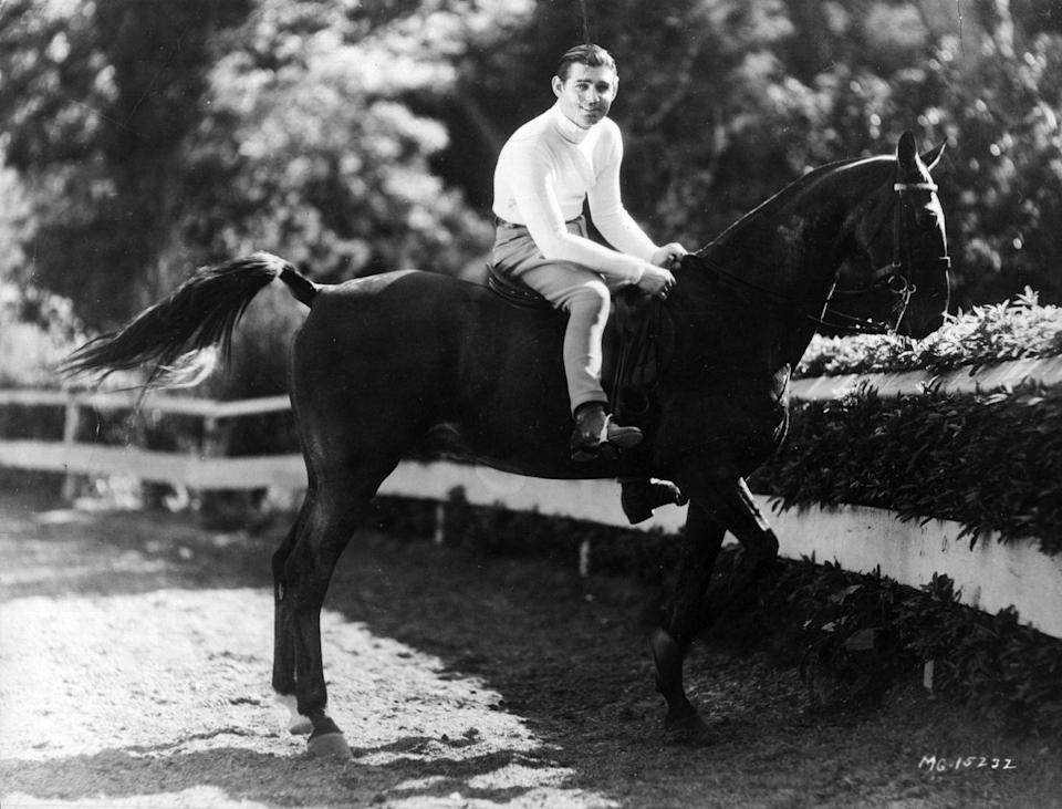 <p>Clark Gable's horse managed to look even more posed than the actor. The leading man and his equine are photographed after a horseback ride in 1940. </p>
