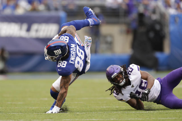 New York Giants tight end Evan Engram (88) is upended by Minnesota Vikings cornerback Trae Waynes (26) during the first quarter of an NFL football game, Sunday, Oct. 6, 2019, in East Rutherford, N.J. (AP Photo/Adam Hunger)