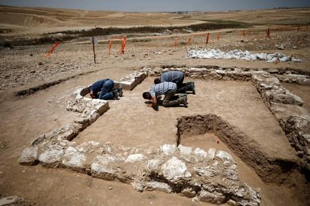 Workers pray inside the remains of a mosque discovered by the Israel Antiquities Authority and which they say is one of the world's oldest mosques, in the outskirts of the Bedouin town of Rahat in southern Israel