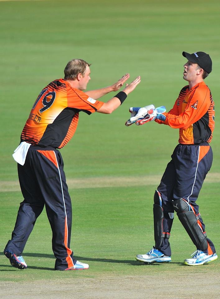 PRETORIA, SOUTH AFRICA - OCTOBER 23: (SOUTH AFRICA OUT) Michael Beer (L) of Perth celebrates the wicket of Gareth Hopkins of Aces with his team-mate Luke Ronchi during the Karbonn Smart CLT20 match between Auckland Aces and Perth Scorchers at SuperSport Park on October 23, 2012 in Pretoria, South Africa. (Photo by Duif du Toit/Gallo Images/Getty Images)