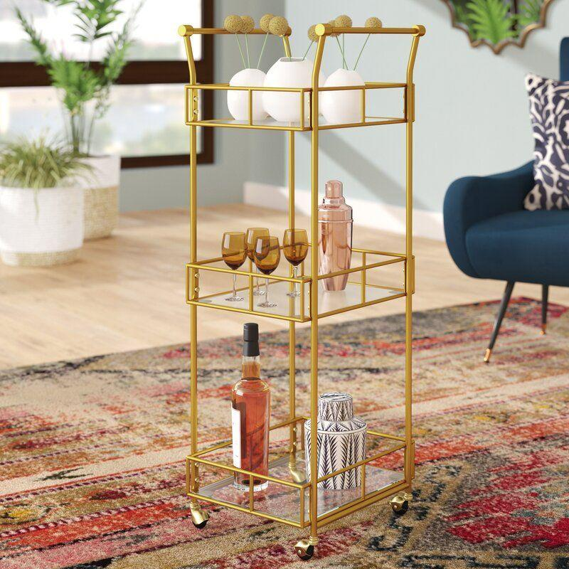 """<p><strong>Mistana</strong></p><p>wayfair.com</p><p><a href=""""https://go.redirectingat.com?id=74968X1596630&url=https%3A%2F%2Fwww.wayfair.com%2Ffurniture%2Fpdp%2Fmistana-armando-3-tier-square-bar-cart-mtna3793.html&sref=https%3A%2F%2Fwww.goodhousekeeping.com%2Flife%2Fmoney%2Fg32932614%2Fwayfair-4th-of-july-sale-2020%2F"""" rel=""""nofollow noopener"""" target=""""_blank"""" data-ylk=""""slk:SHOP NOW"""" class=""""link rapid-noclick-resp"""">SHOP NOW</a></p><p><del>$219.99</del><strong><br>$109.99</strong></p><p>This compact cart is a convenient place to store all your provisions for your next virtual happy hour. Thanks to the four wheels on the bottom, you can easily move this bar cart outside to whip up some backyard beverages. </p>"""