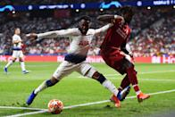 Danny Rose shepherds the ball out of play under pressure from Divock Origi. (Photo by Harriet Lander/Copa/Getty Images)