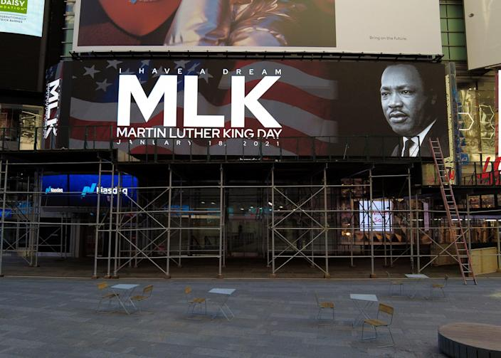 NEW YORK, NEW YORK - JANUARY 18: Digital billboards commemorate Martin Luther King, Jr. Day in Times Square on January 18, 2021 in New York City. (Photo by Dia Dipasupil/Getty Images) (Getty Images)