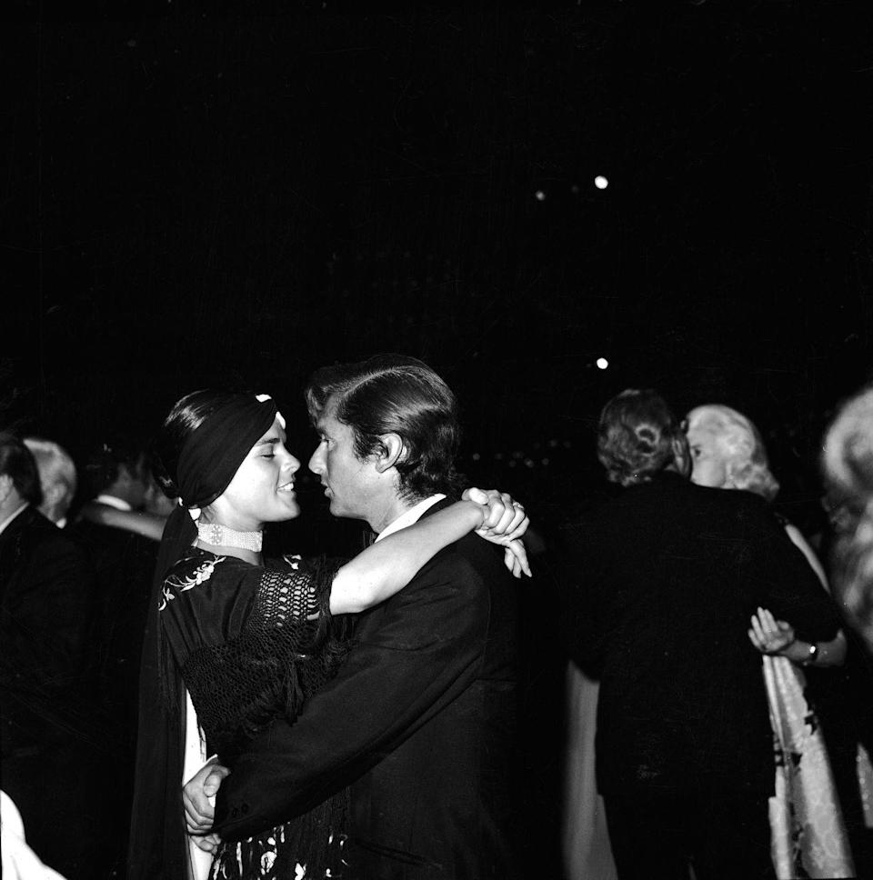 <p>Ali MacGraw and her husband, Robert Evans, steal a slow dance at an Academy Awards after-party in 1970. </p>