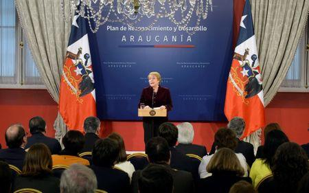 """Chile's President Michelle Bachelet delivers a message asking for forgiveness from Chile's indigenous Mapuche people for """"errors and horrors"""" committed by the state and announcing plans to give them more power and resources, at the government house in Santiago, Chile June 23, 2017. Alex Ibanez/Courtesy of Chilean Presidency/Handout via Reuters ATTENTION EDITORS - THIS IMAGE WAS PROVIDED BY A THIRD PARTY."""