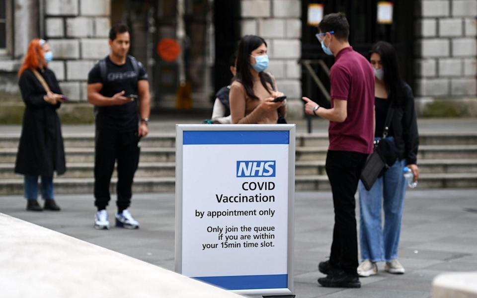 People queue up at a Covid-19 vaccination centre in London on 26 July 2021 - Andy Rain/Shutterstock