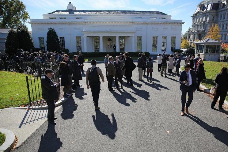 Reporters stand outside of the Oval office at the White House as President-elect Donald Trump meets U.S. President Barack Obama at the White House. (Photo: Carlos Barria/Reuters)