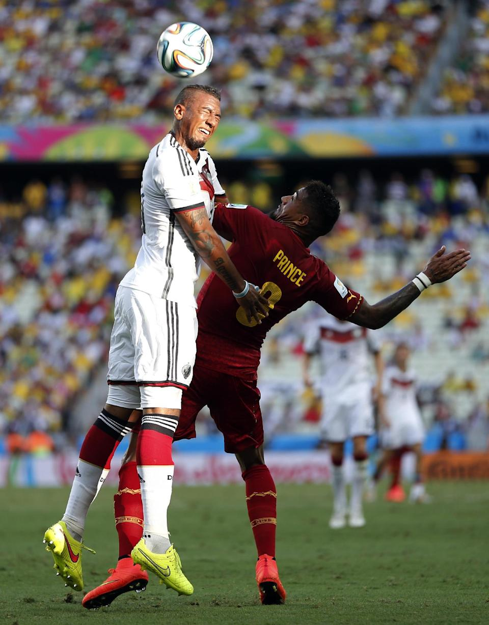 Ghana's Kevin-Prince Boateng, right, challenges Germany's Jerome Boateng during the group G World Cup soccer match between Germany and Ghana at the Arena Castelao in Fortaleza, Brazil, Saturday, June 21, 2014. (AP Photo/Matthias Schrader)
