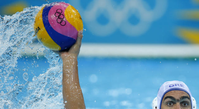 Greece's Theodoros Chatzitheodorou looks on for a shot during their men's preliminary round Group A water polo match against Spain at the London 2012 Olympic Games at the Water Polo Arena August 4, 2012. REUTERS/Laszlo Balogh (BRITAIN - Tags: SPORT OLYMPICS SPORT WATER POLO)
