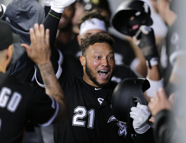 Chicago White Sox's Welington Castillo celebrates in the dugout after hitting a grand slam on a pitch from Seattle Mariners' Brandon Brennan during a baseball game, Sunday, Sept. 15, 2019, in Seattle. (AP Photo/John Froschauer)