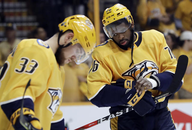 Nashville Predators defenseman P.K. Subban (76) and left wing Viktor Arvidsson (33), of Sweden, wait for play to resume against the Winnipeg Jets in the final moments Game 7 of an NHL hockey second-round playoff series Thursday, May 10, 2018, in Nashville, Tenn. The Jets won 5-1, and advanced to the Western Conference final. (AP Photo/Mark Humphrey)