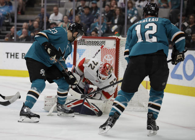Florida Panthers goalie Sergei Bobrovsky (72) blocks a shot from San Jose Sharks' Patrick Marleau (12) during the first period of an NHL hockey game Monday, Feb. 17, 2020, in San Jose, Calif. At left is Sharks' Barclay Goodrow (23). (AP Photo/Ben Margot)