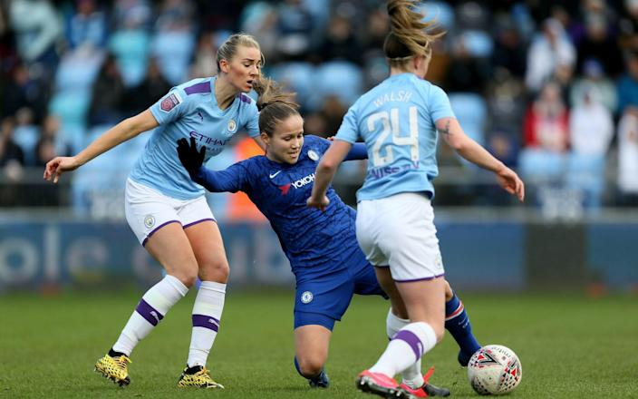 Chelsea women's Guro Reiten and Manchester City's Keira Walsh challenge during the Women's Super League - PA