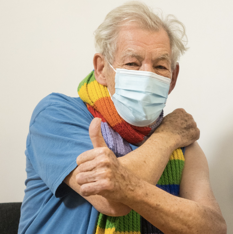 Sir Ian McKellen gives a thumbs up after getting the COVID-19 vaccine.
