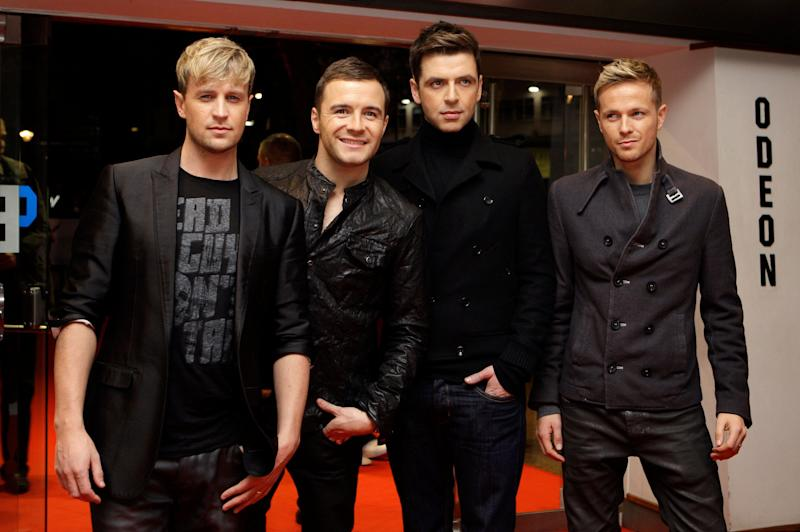 """Irish band Westlife arrives at London's Leicester Square Odeon West End Cinema for the British premiere of Michael Jackson's """"This Is It"""" on Wednesday, Oct. 28, 2009. (AP Photo/Joel Ryan)"""