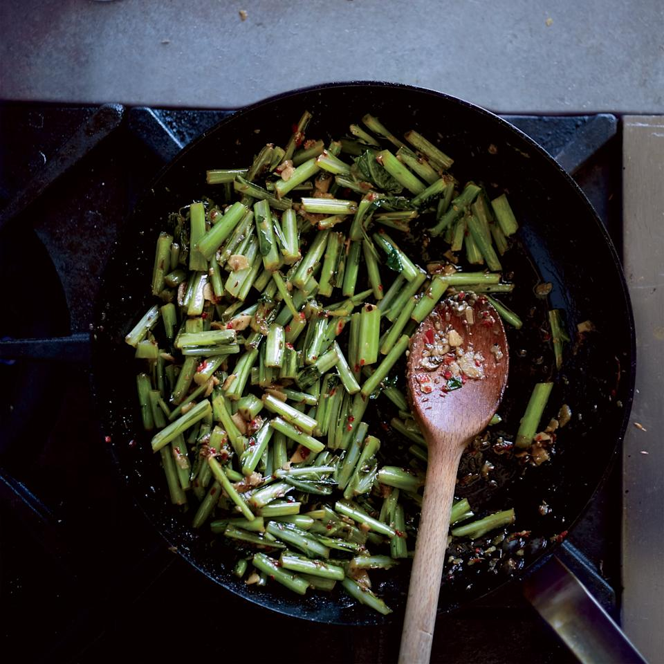 """<p>This dish is a genius way to use up the stems of any hardy green. We used collard stems, but you could also use kale, chard or mustard stems.</p><p><a href=""""https://www.foodandwine.com/recipes/cumin-and-chile-braised-collard-green-stems"""">GO TO RECIPE</a></p>"""