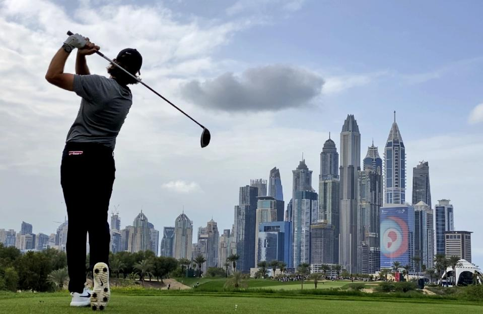 England's Tommy Fleetwood follows his ball on the 8th hole during the second round of the Dubai Desert Classic golf tournament in Dubai, United Arab Emirates, Friday, Jan. 24, 2020. (AP Photo/Kamran Jebreili)