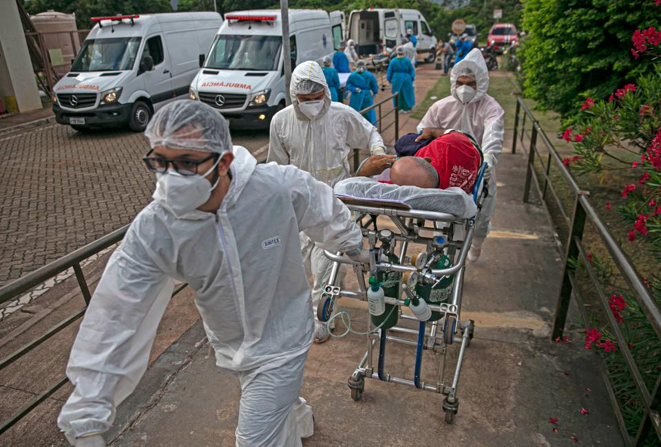 A COVID-19 patient is transferred from the Emergency Care Unit of Santarem, Para state, Brazil, to another hospital of Para, on February 7, 2021. (Photo by TARSO SARRAF / AFP) (Photo by TARSO SARRAF/AFP via Getty Images)
