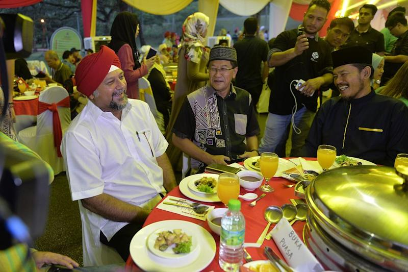 Multimedia and communication minister Gobind Singh Deo sitting with muslim guests for iftar during the National Vaisakhi celebration open house in Kuala Lumpur May 26, 2019.