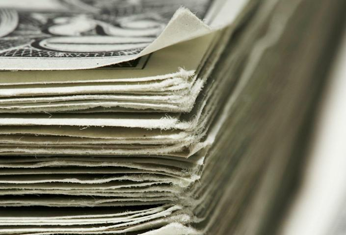 """<span class=""""caption"""">Government spending bills that cost billions or trillions of dollars can seem abstract.</span> <span class=""""attribution""""><a class=""""link rapid-noclick-resp"""" href=""""https://www.gettyimages.com/detail/photo/stack-of-us-dollar-banknotes-close-up-royalty-free-image/200556773-001"""" rel=""""nofollow noopener"""" target=""""_blank"""" data-ylk=""""slk:Siri Stafford/DigitalVision via Getty Images"""">Siri Stafford/DigitalVision via Getty Images</a></span>"""
