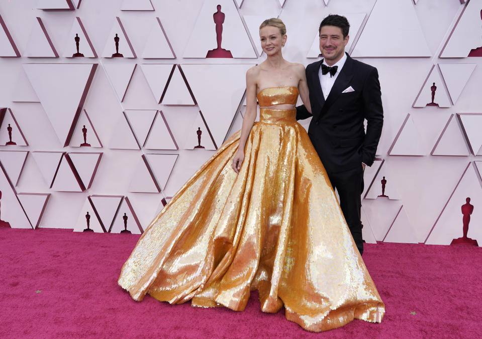 Carey Mulligan, left, and Marcus Mumford arrive at the Oscars on Sunday, April 25, 2021, at Union Station in Los Angeles. (AP Photo/Chris Pizzello, Pool)