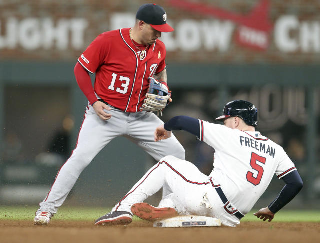 Atlanta Braves runner Freddie Freeman (5) is out on a force-out at second base as Washington Nationals second baseman Asdrubal Cabrera (13) takes the throw during the sixth inning of a baseball game Saturday, Sept. 7, 2019, in Atlanta. (AP Photo/Tami Chappell)