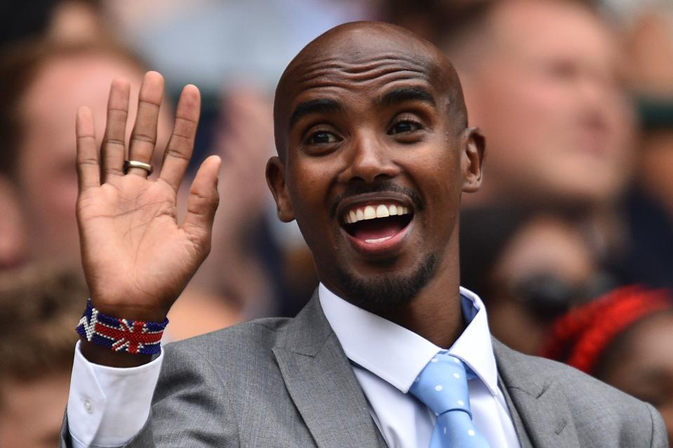 British athlete Mo Farah waves as he is presented in the Royal Box on Centre Court at The All England Tennis Club in Wimbledon, southwest London, on July 6, 2019, on the sixth day of the 2019 Wimbledon Championships tennis tournament. (Photo by Glyn KIRK / AFP) / RESTRICTED TO EDITORIAL USE        (Photo credit should read GLYN KIRK/AFP via Getty Images)