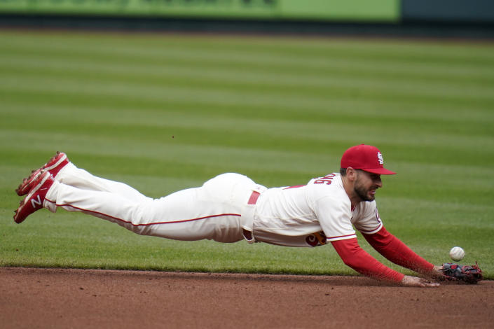St. Louis Cardinals shortstop Paul DeJong dives for a single by Cincinnati Reds' Jonathan India during the second inning of a baseball game Saturday, April 24, 2021, in St. Louis. (AP Photo/Jeff Roberson)