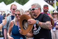 <p>Guy Fieri proves he's the mayor of Flavortown at the Food & Wine Classic in Aspen, Colorado, on Sept. 11.</p>