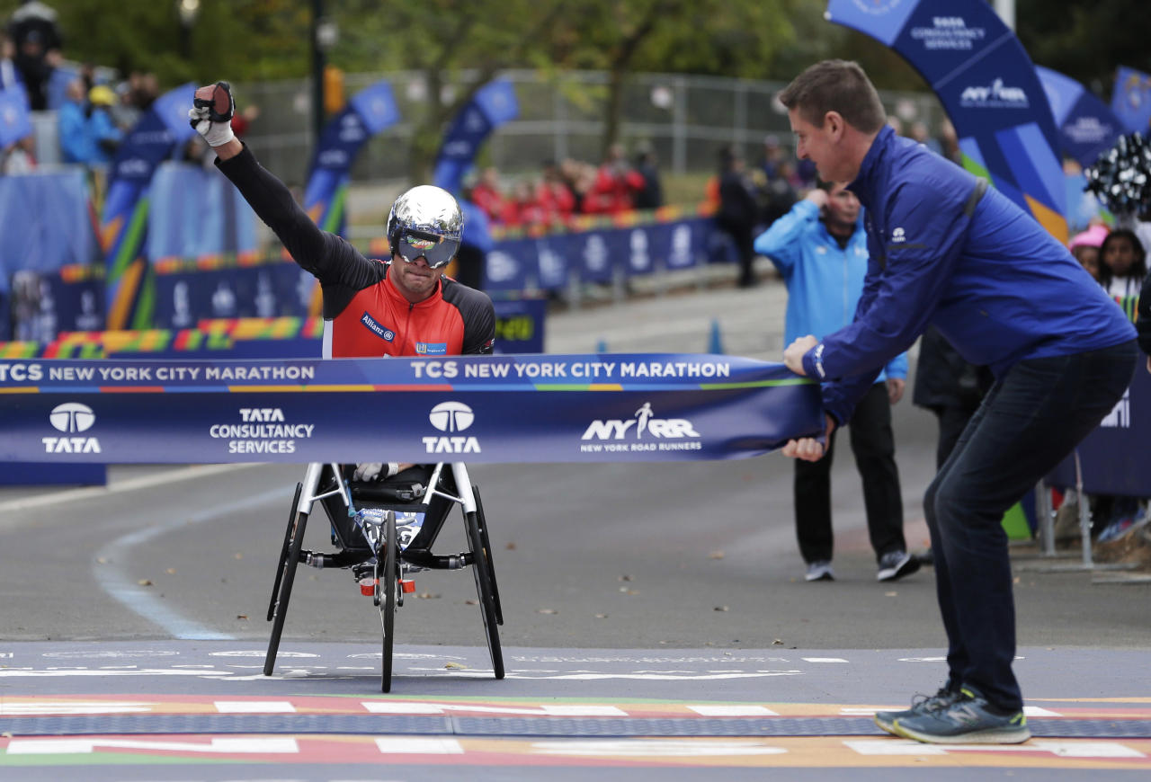 <p>Marcel Hug of Switzerland crosses the finish line first in the men's wheelchair division of the New York City Marathon in New York, Sunday, Nov. 5, 2017. (Photo: Seth Wenig/AP) </p>