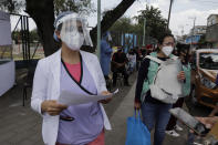 Information brigade in Lomas de San Lorenzo, Iztpalapa, on July 15, 2020, one of the colonies of Mexico City that returned to a lockdown due to the high number of COVID-19 infections in the capital. (Photo by Gerardo Vieyra/NurPhoto via Getty Images)